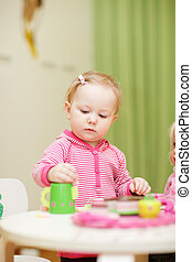 Little girl playing with toys