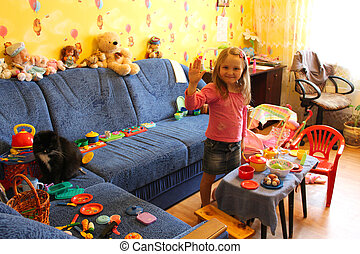 little girl playing with toys in her room