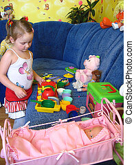 girl playing with toys in her room