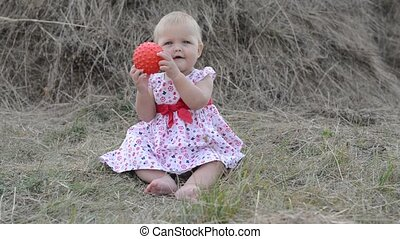 little girl playing with toys on th
