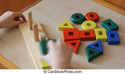 little girl playing with wooden puzzle 6023