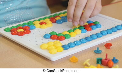 Little girl plays a intellectual educational game - The...