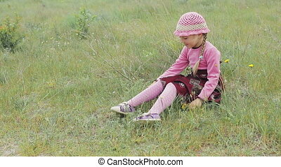 little girl plays on the field