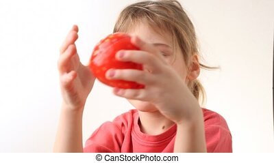 little girl plays with kitchen timer in strawberry form