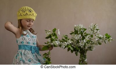 Little girl plucking and flinging flowers