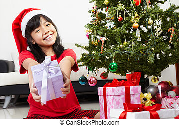 Little girl pointing Christmas present
