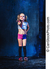 Little girl pointing in toy gun - Halloween theme: Little...