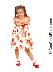 Little girl posing in dress with flowers