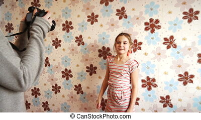 Little girl posing in front of the camera