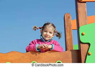 little girl posing in playground