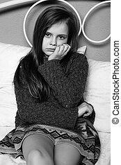 Little girl posing in the studio