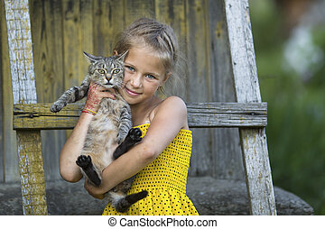 Little girl posing with a cat.