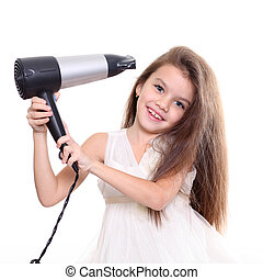 little girl posing with hair dryer