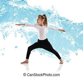 Little girl practice yoga in water splashes.