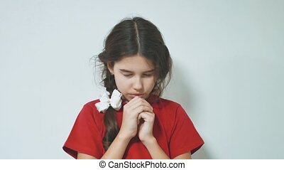 Little girl praying in the morning.Little girl hand praying. Hands folded in prayer concept for faith spirituality and religion. little girl concept lifestyle