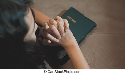 Little girl praying in the night. Little girl hand praying....