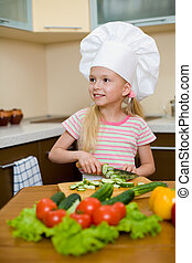 Little girl preparing healthy food on kitchen