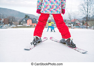 Little girl preparing to ski downhill