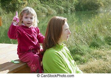 Little girl pretending mother hairdresser