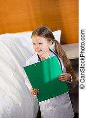 Little girl pretending to be doctor