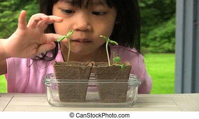 Little Girl Proud Of Her New Plants