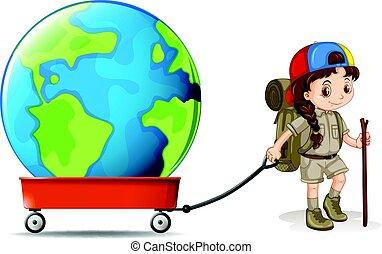 Little girl pulling big earth on wagon