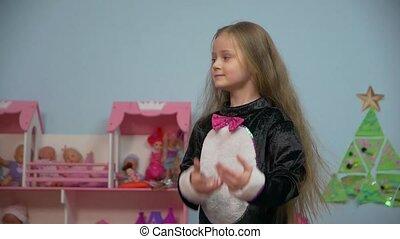 Little Girl Raises Hands - Little caucasian white european 5...