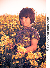 little girl rape field bouquet hand