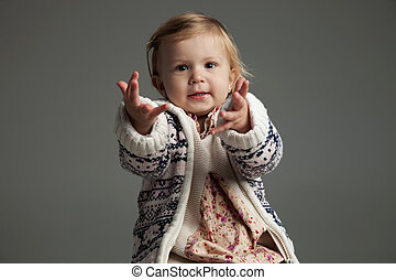 little girl reaching out