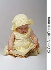 little girl read a book on white background