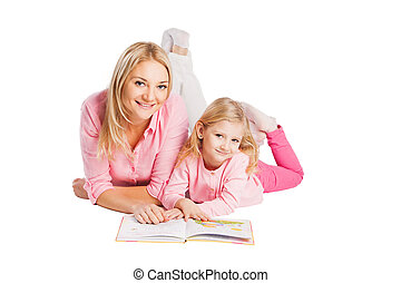 Little girl read book with mother