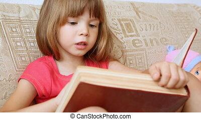 Little girl reading a big book