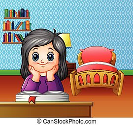 Little girl reading a book in the room