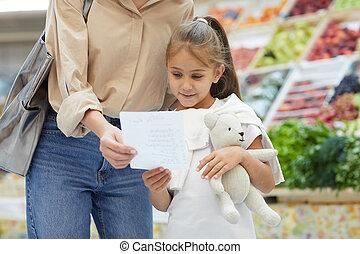 Little Girl Reading Shopping List
