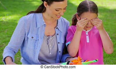 Little girl receiving a kite