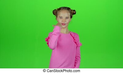 Little girl rejoices in victory. Green screen. Slow motion -...