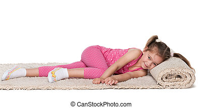 Little girl rests on the carpet