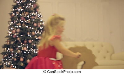 Little girl riding a toy in the New Year's Eve.video full hd