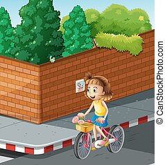 Little girl riding bike on the road