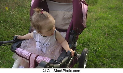 little girl riding in a stroller