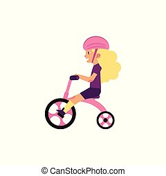Little girl riding tricycle - cute female child wears safety...