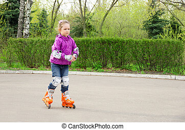 Little girl roller-skating