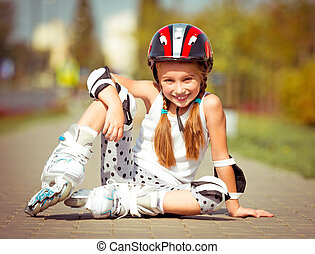 little girl rollerblading