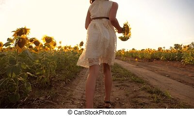 Little girl running cross the wheat field at sunset.Slow...