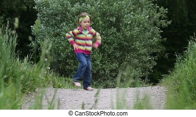 Little girl running from left to the right and backward several times