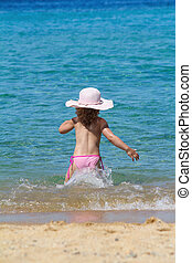 little girl running in sea