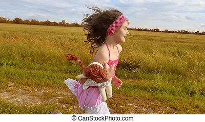 Little girl running on meadow with sunset. Toned. girl kid...