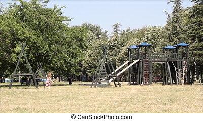 little girl running on playground