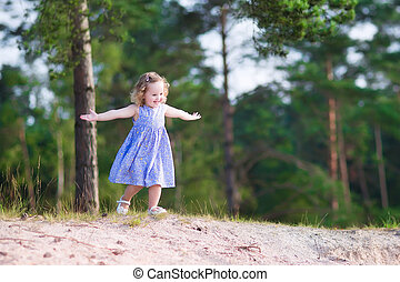 Little girl running on sand dunes - Adorable child, ilttle...