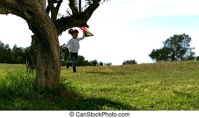 Little girl running with kite